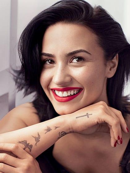 Demi Lovato tattoo on the cover of Allure magazine #demilovato #cross #birds