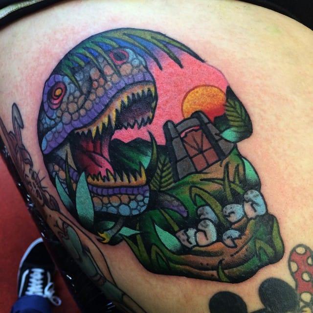 Jurassic themed skull tattoo by Sam Kane
