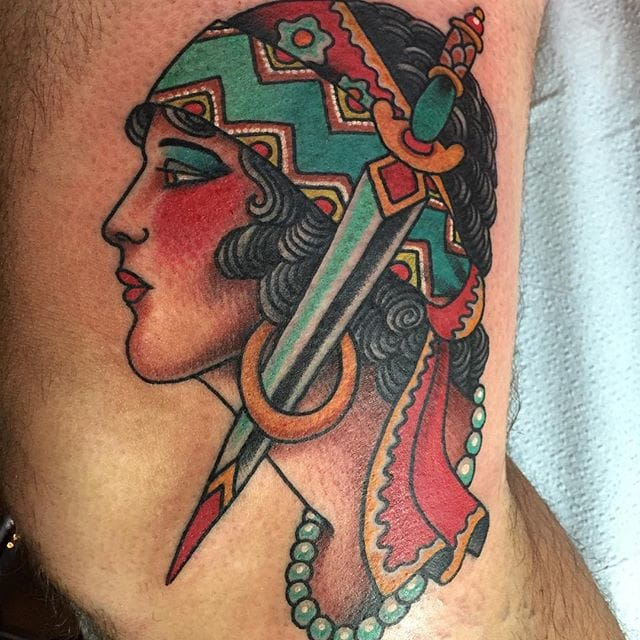 Girl and dagger, tattoo by Todd Noble