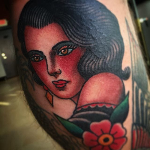 Bold and solid colors, tattoo by Todd Noble