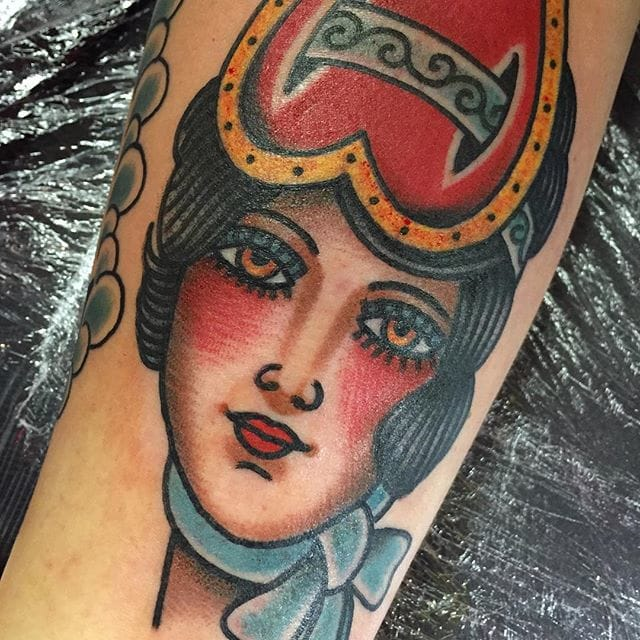 Girl head with heart, tattoo by Todd Noble