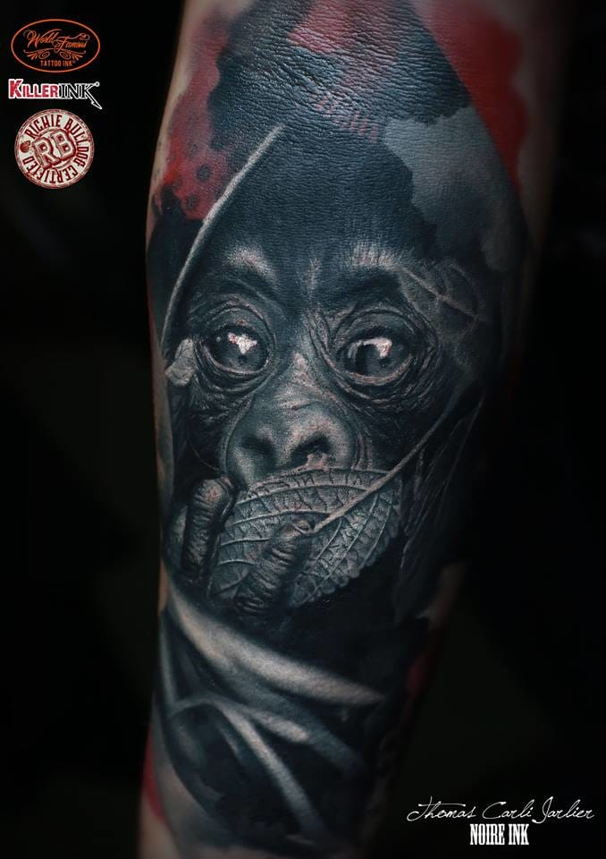 Adorable monkey on this artistic and dark tattoo