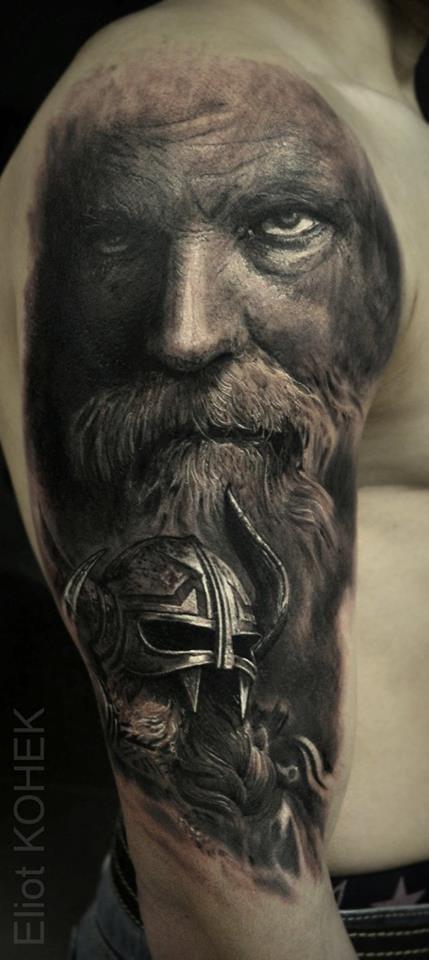 Intense Viking tattoo. Grey realism By Eliot Kohek