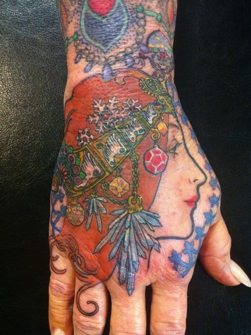 Elegant hand tattoo by Lucy Hu.