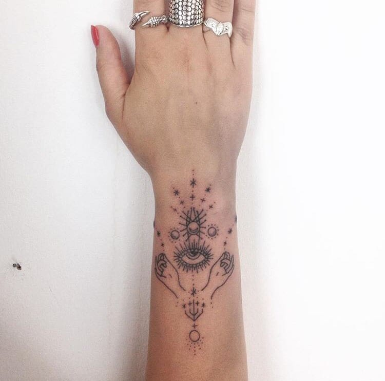 Wrist Tattoo by Tatiana Kartomtem #wristtattoo #handpoke #eye #ornaments #geometric