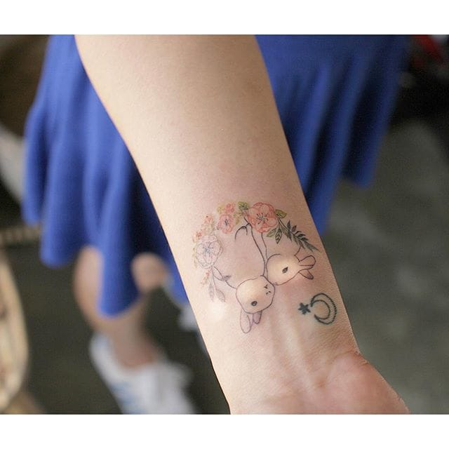 A really great idea for wrist tattoos for women that's not too imposing and not too lacklustre is a lovely South Korean-inspired piece characterised by a single needle work and pastel colours. By tattooistmuha/Instagram