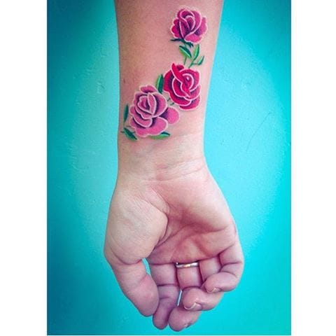 Wrist tattoos for women with solid color like this rose tattoo by Briana Juju #rose #wrist #brianajuju