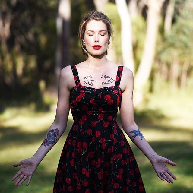 Gorgeous Crime Writer Tara Moss Gets Birdcage And Rose Tattoo