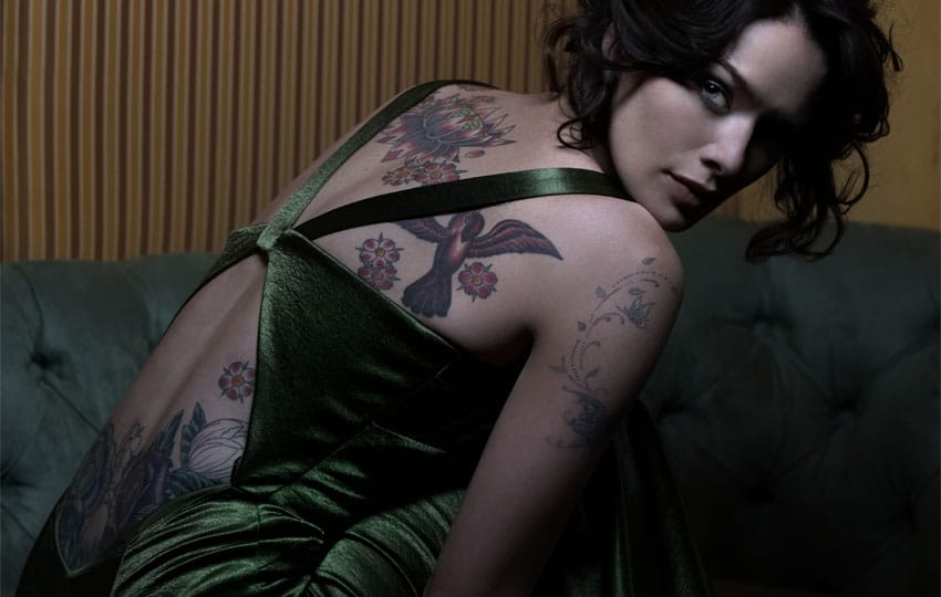 The gorgeous actress has a her upper and lower back tattooed with more floral designs and birds
