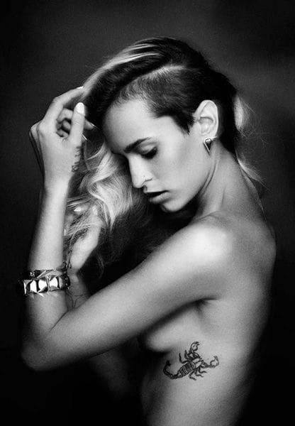 Alice's ribcage tattoo of a scorpion