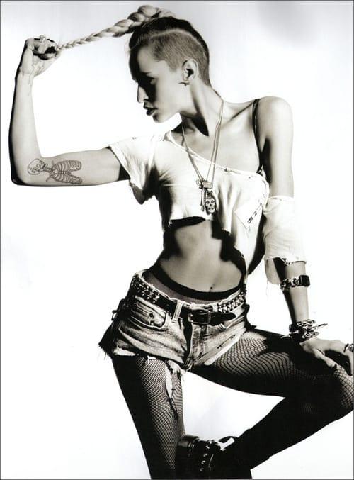 Her inner arm tattoo of part skeleton is pretty rock n roll