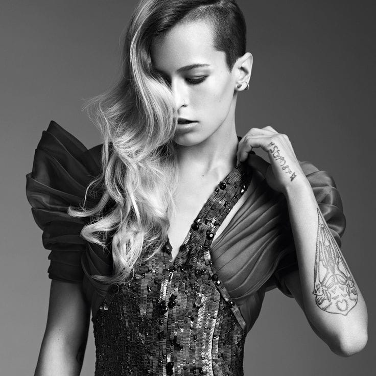 Alice has a bird skull on her left forearm the tattoo makes a striking contrast in her modelling photoshoots