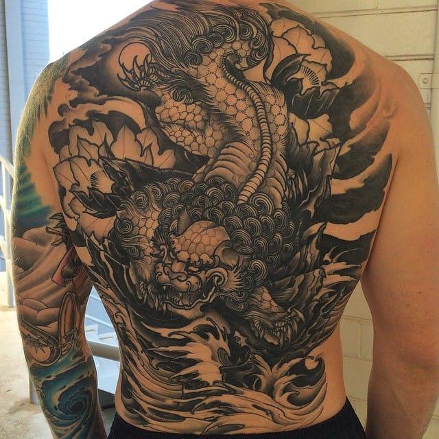 Foo dog back tattoo by Daniel Formentin