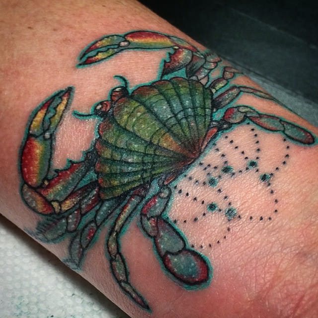Check out the awesome detail on this crab tattoo!