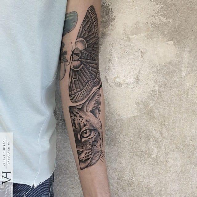 Moth tattoo and symmetrical feline half-portait