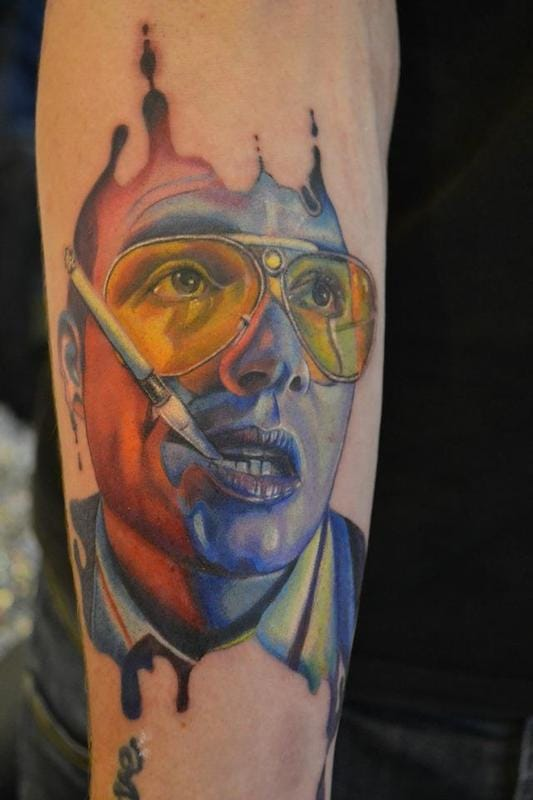 Psychedelic colorful tattoo of Raoul Duke from the acid trip scene in the movie.