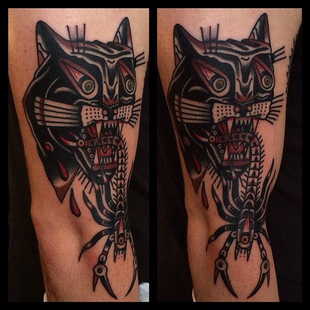 Solid cat and scorpion tattoo