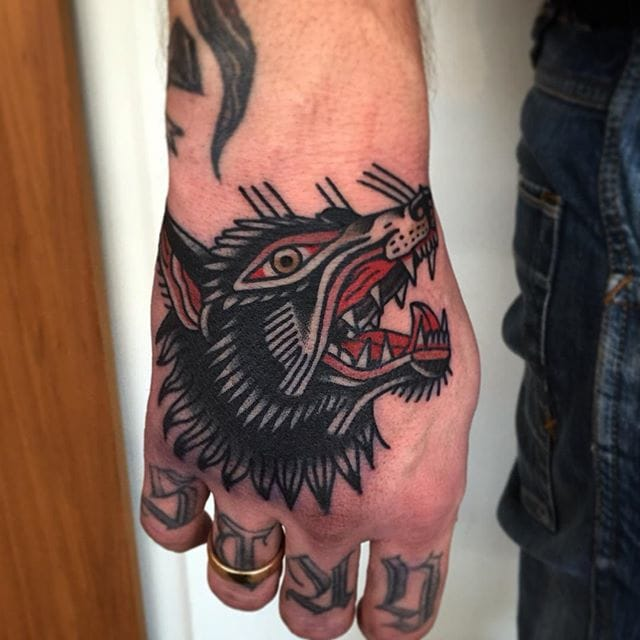 Wolf head hand tattoo