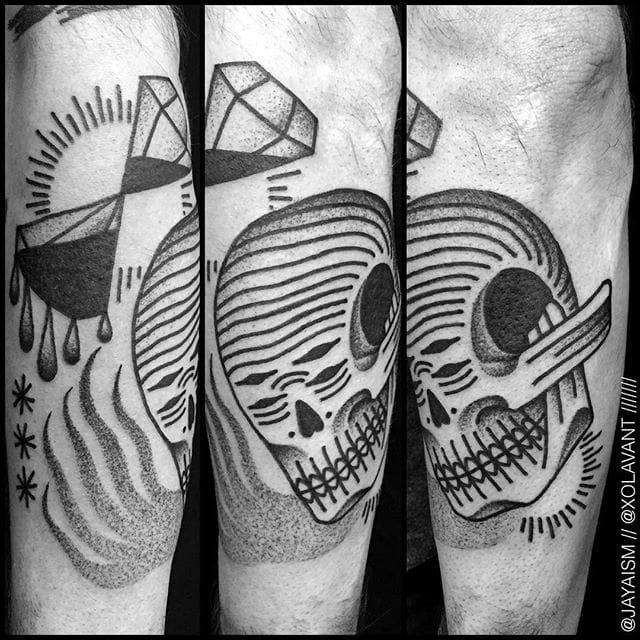 Skull tattoo with diamonds