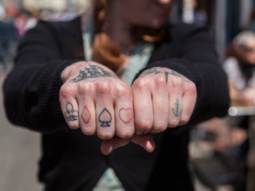Card suit symbols on the fingers.