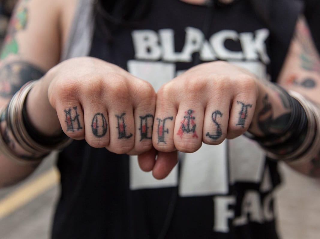 Hold Fast knuckle tattoo.