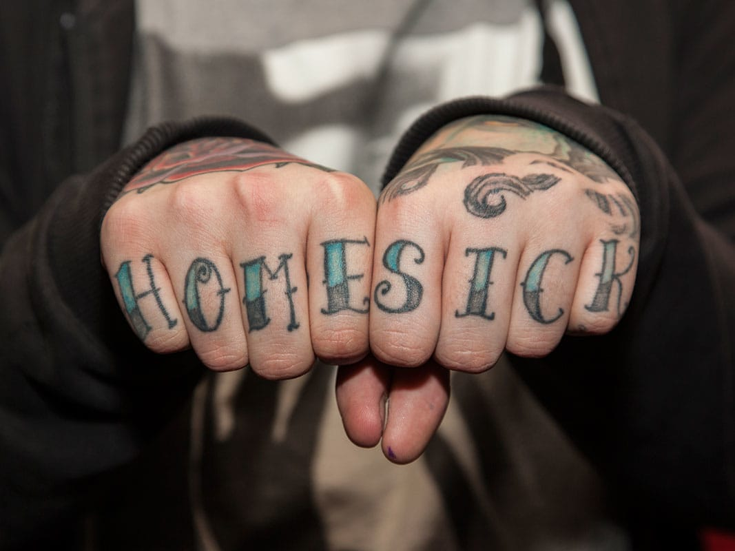 Home Sick knuckle tattoo.
