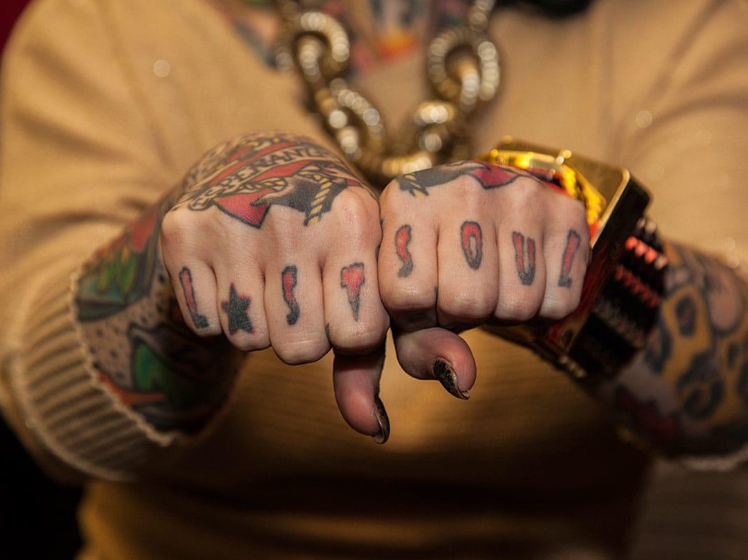 Lost Soul knuckle tattoo.