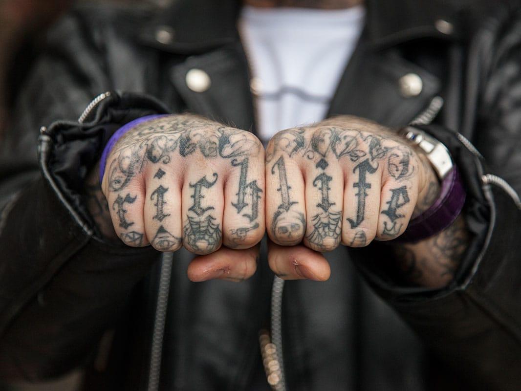 Rich Life knuckle tattoo.