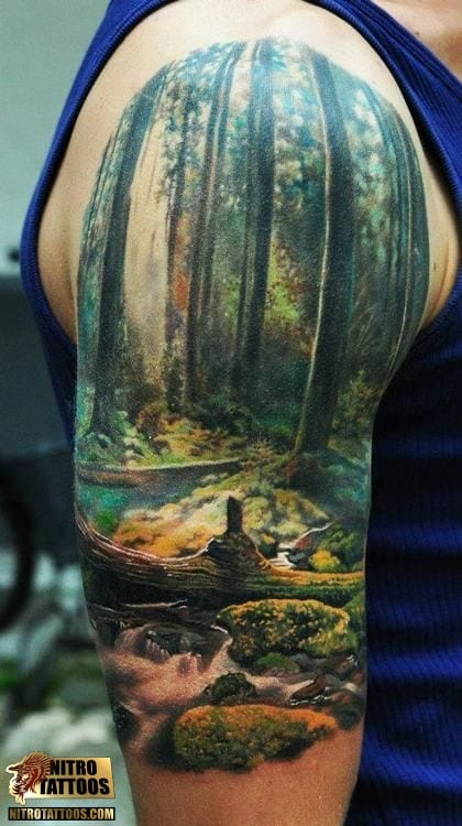 The forest would be a nice place for solitude. Awesome realistic Landscape Tattoo done at Nitro Tattoos.