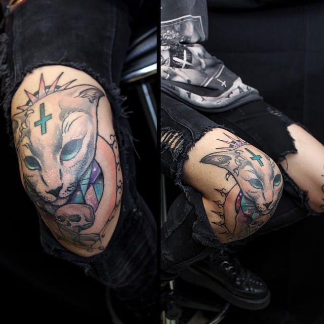 Cat knee tattoo by Anzo Choi