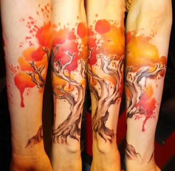 A watercolor lover? Red trees are a great idea for a trendy yet gorgeous tattoo. Artist unknown, please let us know.