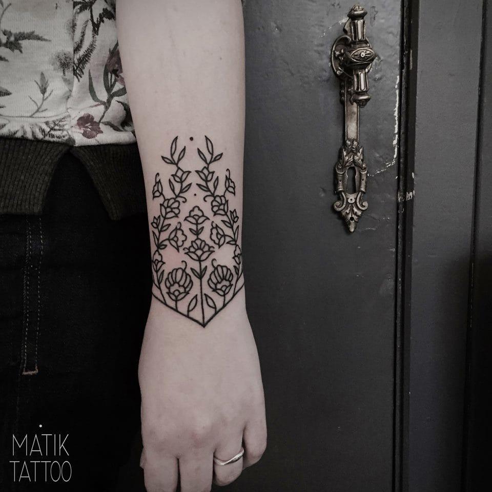 Charming wrist tattoo.