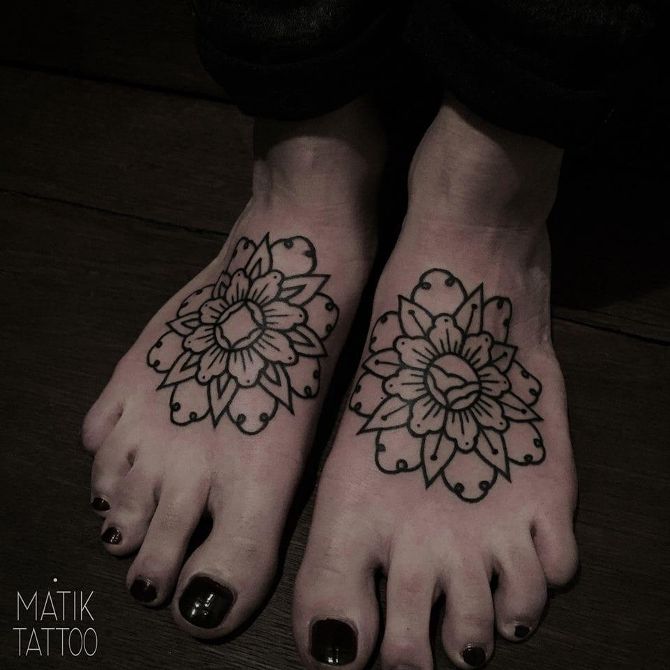 Dainty feet tattoos.