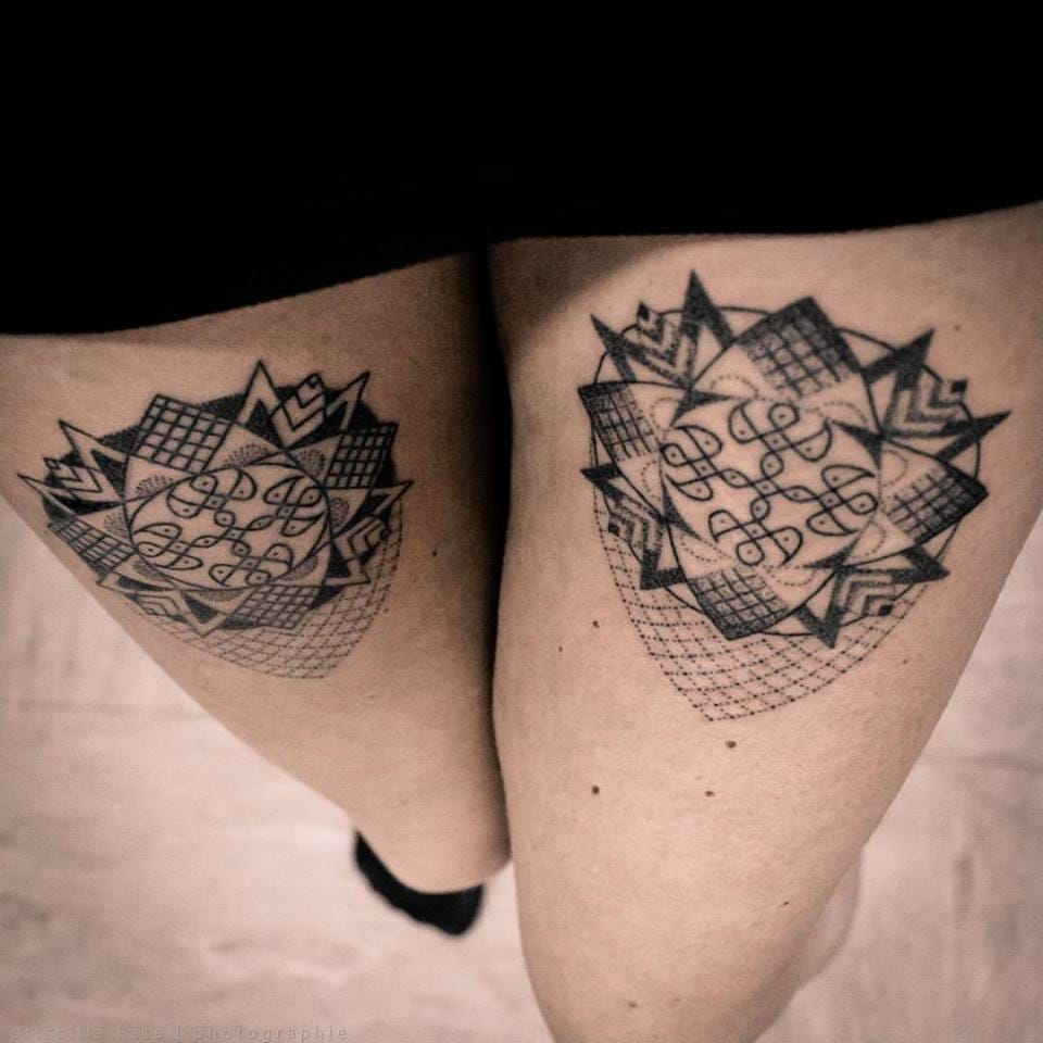 Elegant matching tattoos by Priscilla Kata.
