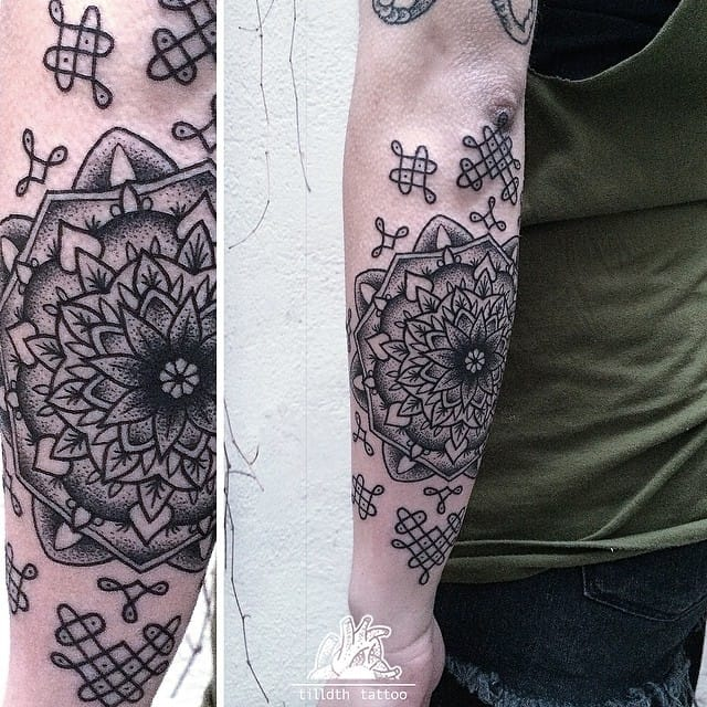 Ornated mandala tattoo by Sarah Herzdame.
