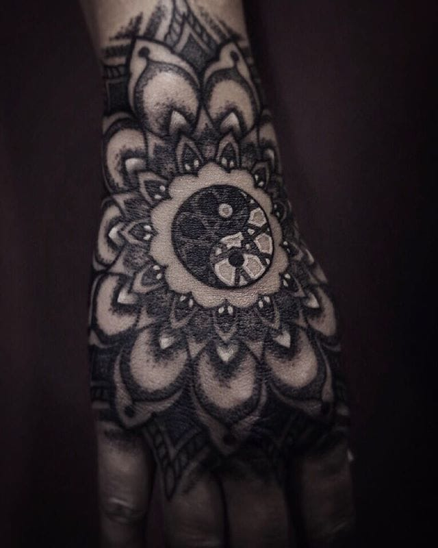 Terrific hand tattoo by Arang Eleven