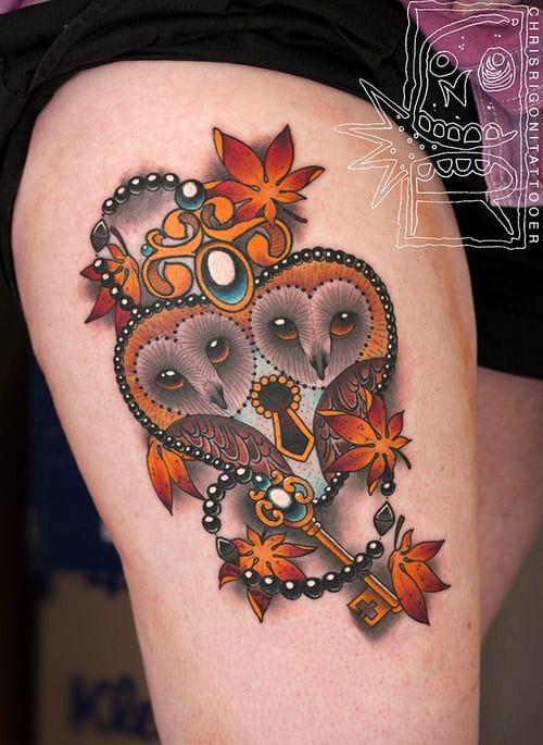 Adorable owls lock tattoo by Chris Rigoni.