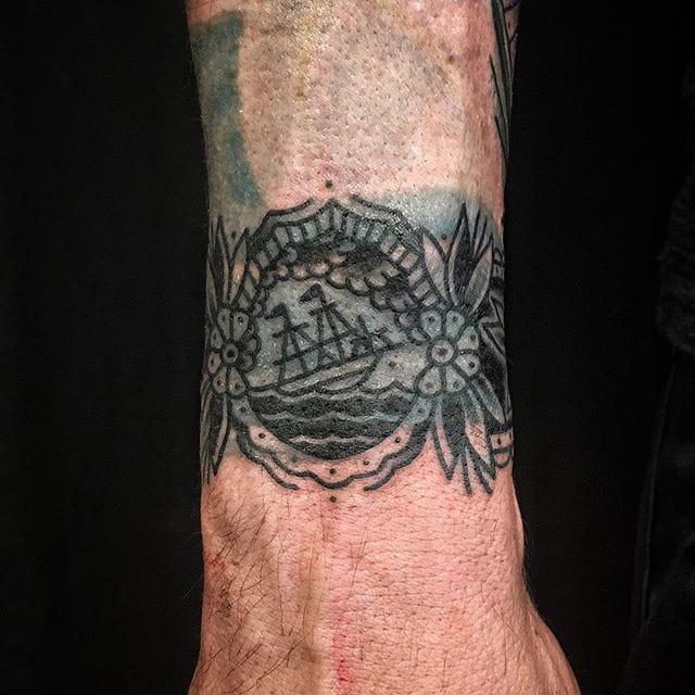 Blast Over Cuff Tattoo by Bastien Jean