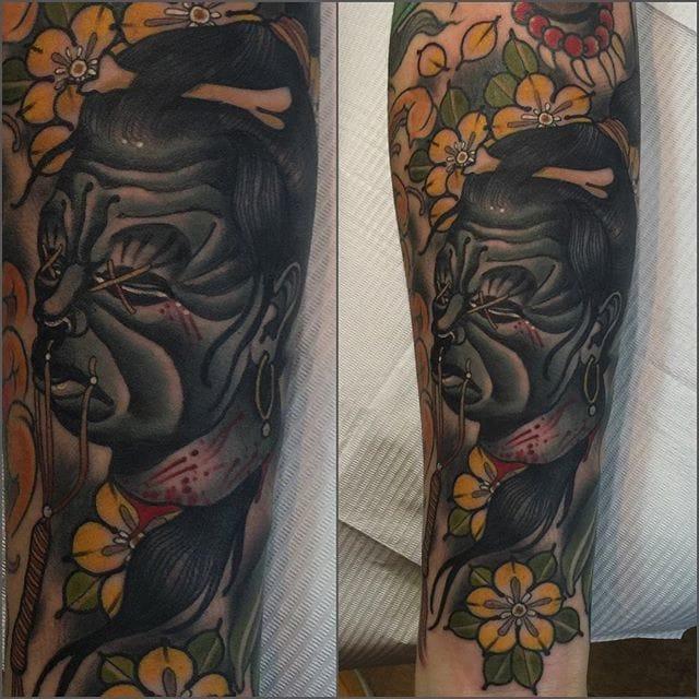 Shrunken Head Tattoo by Matt Adamson