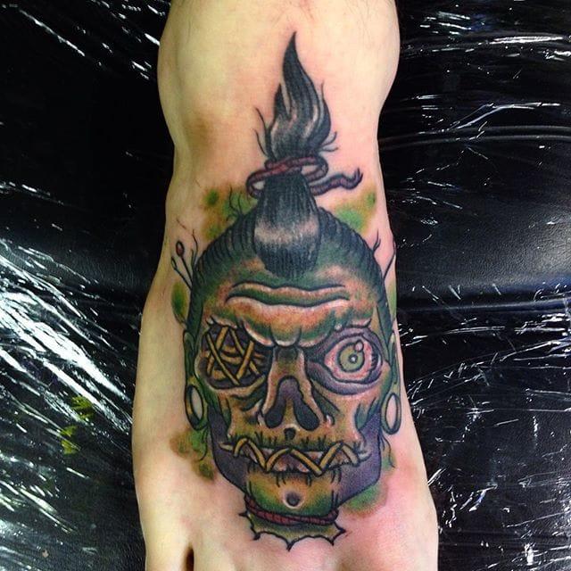 Shrunken Head Tattoo by Myke Peters
