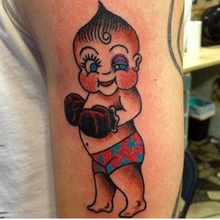 'Don't get knocked out' Kewpie by Terry Brown