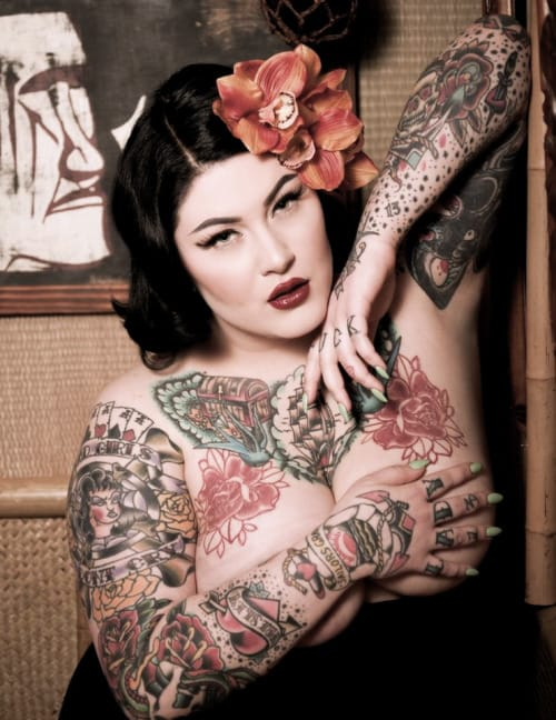 Dallas Valentine has to be one of the most beautiful pin up models of today. She's got the look and some drop dead gorgeous ink. Photo by Existential photography
