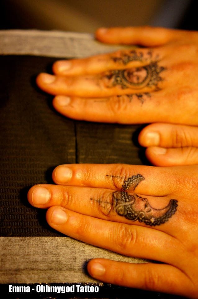 Wedding ring tattoo ideas can include more than one finger... Via Emma Bundonis.