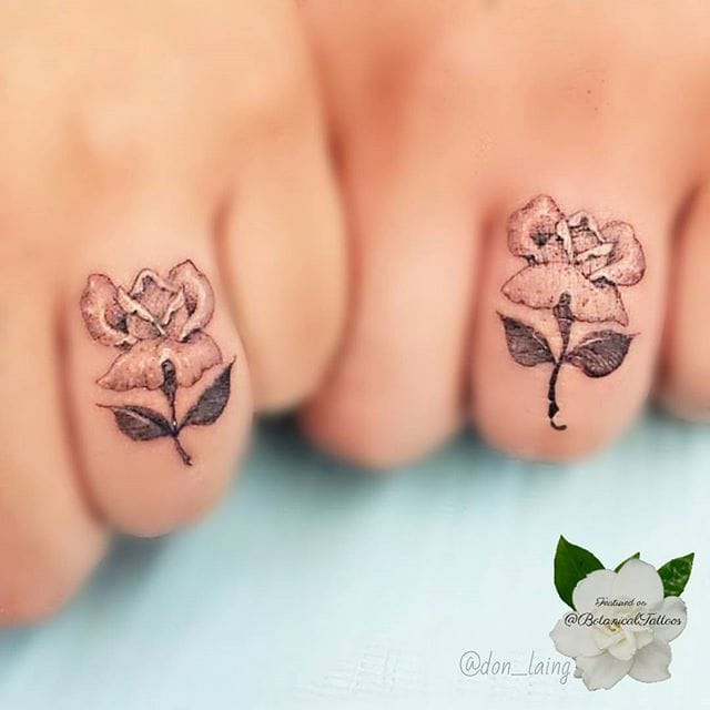 Matching tattoos are adorable. Via Don Laing.