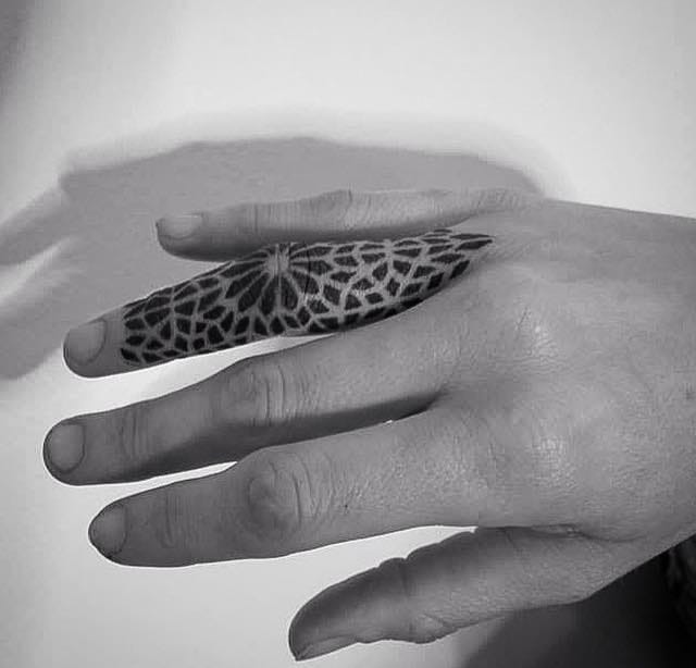 Why not covering your fingers with bold tattoos? That's how huge your love is after all. Via Corey Divine.