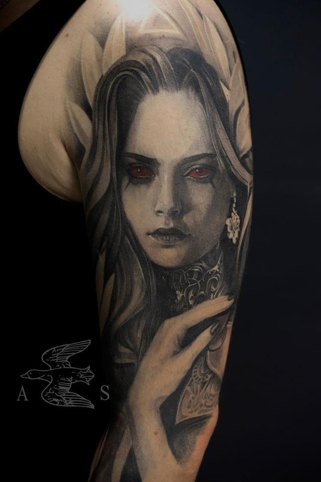 Vampiric Cara Delevingne tattoo