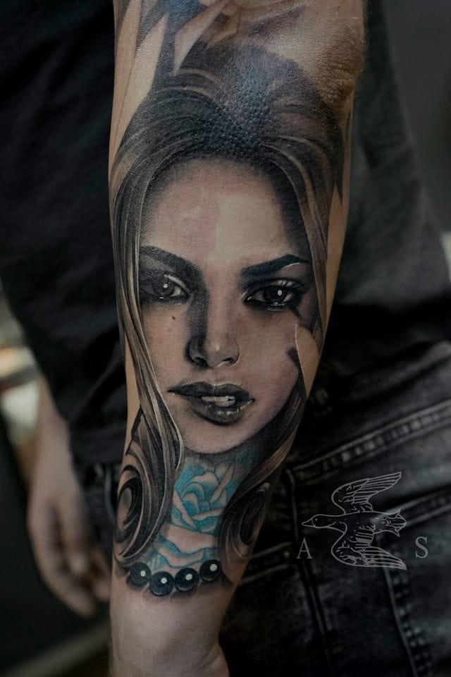 Girl with blue roses tattooed on the neck. Beautiful tattoo!