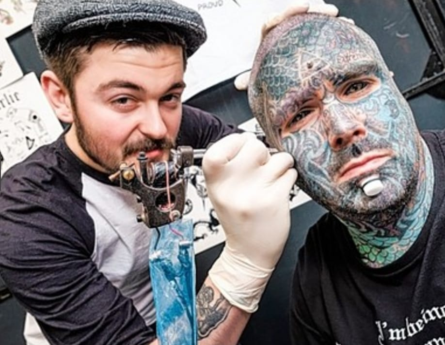 King of Inkland King Body Art The Extreme Ink-ite getting tattooed by artist Charlie Black