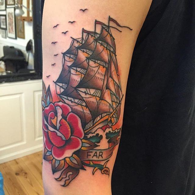 Creative ship with flowers tattoo
