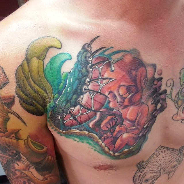 This unusual chest piece might represent life death and nature? What do you think?